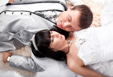 Married couple lying on floor Stock Photo