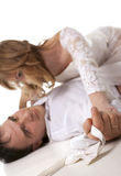 Married couple lying on the floor together Stock Photo