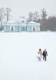 Married couple in the middle of snowy field Stock Photo