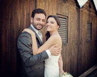 Married couple near wooden cabins Royalty Free Stock Photos