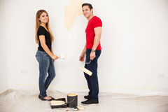 Married couple painting a room Stock Photos