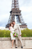 Married couple in Paris, posing near Eiffel Tower Royalty Free Stock Photography