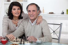 Married couple playing chess Stock Images