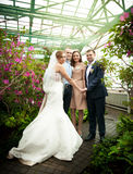 Married couple posing with friends at greenhouse Stock Images