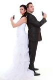 Married couple problem discord, bride groom with gun. Bad relationship concept - married couple problem discord. Bride and groom with handgun. Man women in Royalty Free Stock Photos