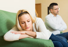 Married couple after quarrel. Despait married couple after quarrel in living room at home Royalty Free Stock Image