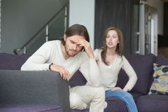 Young man and woman quarreling at home stock photos