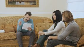 Married couple quarrels at the psychologist`s reception. Married couple sits on the sofa in the room at a psychologist`s reception. The woman blames her husband stock video footage