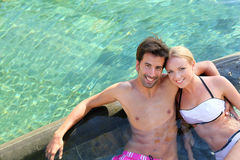 Married couple in resort pool Royalty Free Stock Photos