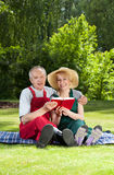 Married couple resting in garden Royalty Free Stock Image