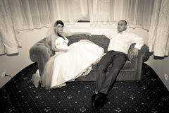 Married couple resting on the sofa Stock Photography