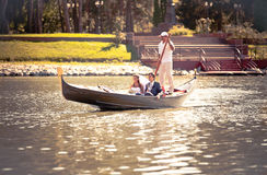 Married couple riding on gondola on river Stock Images
