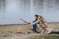 Married couple at the river during the autumn period Stock Photography