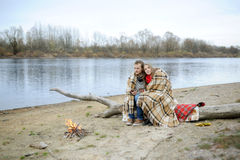 Married couple at the river during the autumn period Stock Photos