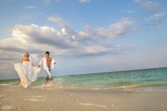 A married couple running in sunshine Stock Image