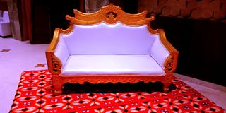 married couple seating object with red carpet stock photo royalty free stock photo