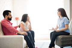 Married couple seeking consultation for happy life. Married couple having relationship difficulties meeting psychologist for consultation and solutions for happy royalty free stock images