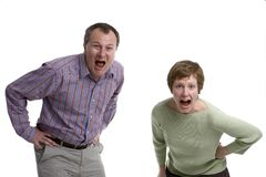 Married couple shouting. Man and woman shouting Royalty Free Stock Photography