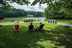 Married Couple Sitting by the Lake Stock Image