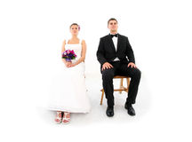 Married couple sitting over white background Royalty Free Stock Photos
