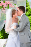 Married couple standing in alcove and kissing Stock Photo