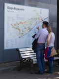 A married couple studying the map of Gorky Park. Moscow - May 9, 2016: A young couple studying a map to visit and relax in the Gorky Park May 9, 2016, Moscow stock image