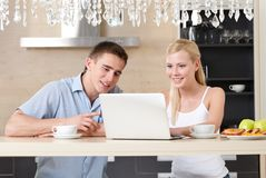 Married couple surfs on the internet Royalty Free Stock Photography