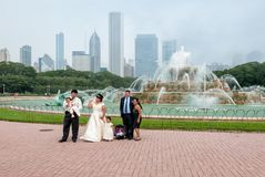 Married couple with their small children visiting Buckingham Memorial Fountain in the Chicago Grant Park. Stock Image