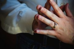 Married couple touching finger tips. Married couple affectionately touching finger tips cropped close up royalty free stock photography