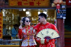 A married couple in a traditional dress, Shu-He is the village where the bride and groom come to be photographed, Shu-He, Lijiang, stock photo