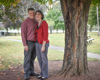 Married Couple Under Tree. A sweet, happily married couple underneath a tree Stock Photos