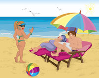 Married Couple Under Umbrella On The Beach Stock Photography