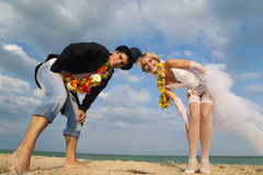 A married couple walking on beach Royalty Free Stock Images