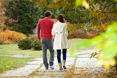 Married couple walking. Down the alley park Stock Images