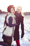 Married couple walking. Healthy walk in winter on the frozen field covered with snow Stock Photography