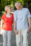 Married couple walking through the park Royalty Free Stock Photos