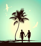 Married couple walking on tropical island Royalty Free Stock Images