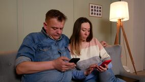 Married couple watching something on mobile internet