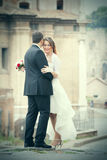 Married couple with wedding dress in the city stock image