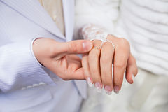 Married couple. Wedding photograph of a young couple of lovers who are just married, are close to each other in harmony, love and happiness. Groom holds the Royalty Free Stock Photo