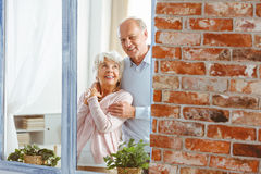 Married couple by the window Stock Image