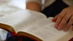 Married female reading the bible book stock video