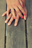 Married hands. Hands of married people on wooden background royalty free stock images