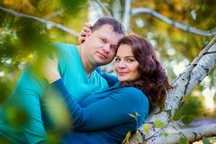 The woman and the man embrace in the park. Married happy couple on walk in the park Royalty Free Stock Images