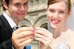 Married holding the rings Stock Photos