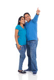 Married indian couple. Cheerful young married indian couple pointing on white background Royalty Free Stock Photography