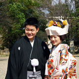 Married japanese couple. Kyoto, Japan - March 25, 2012: Married couple wearing traditional costumes during wedding ceremony in Kyoto Royalty Free Stock Photography