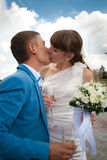 Married kissing on the background of sky Royalty Free Stock Photography