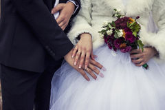 The married people, hands and fingers with rings, flowers Royalty Free Stock Images