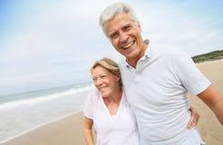 Married senior couple being happy enjoying beach Stock Photo